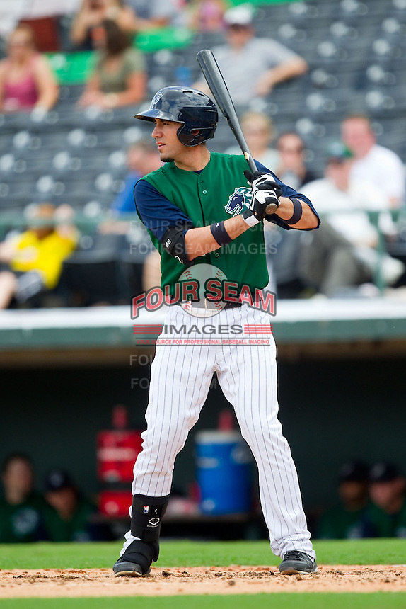 Travis Ishikawa (14) of the Charlotte Knights at bat against the Durham Bulls at Knights Stadium on August 18, 2013 in Fort Mill, South Carolina.  The Bulls defeated the Knights 8-5 in Game One of a double-header.  (Brian Westerholt/Four Seam Images)