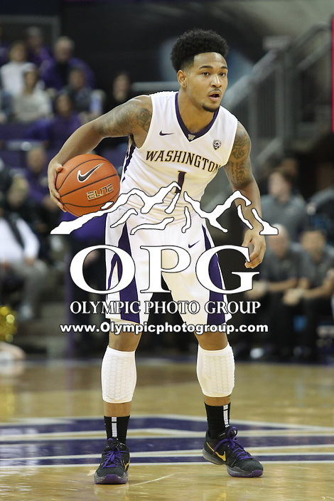 JAN 1, 2016:  Washington's #1 David Crisp brings the ball down court against UCLA.  Washington defeated #25 ranked UCLA 96-93 in double overtime at Alaska Airlines Arena in Seattle, WA.