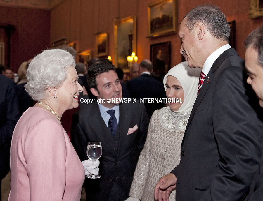 "THE QUEEN MEETSRECAP TAYYIP ERDOGAN, PRIME MINISTER OF TURKEY AND WIFE EMINE ERDOGAN.The Queen met G20 Summit world leaders at a reception at Buckingham Palace, London_01/04/2009..Photo Distributed by : Newspix International..**ALL FEES PAYABLE TO: ""NEWSPIX INTERNATIONAL""**..PHOTO CREDIT MANDATORY!!: NEWSPIX INTERNATIONAL(Failure to credit will incur a surcharge of 100% of reproduction fees)..IMMEDIATE CONFIRMATION OF USAGE REQUIRED:.Newspix International, 31 Chinnery Hill, Bishop's Stortford, ENGLAND CM23 3PS.Tel:+441279 324672  ; Fax: +441279656877.Mobile:  0777568 1153.e-mail: info@newspixinternational.co.uk"