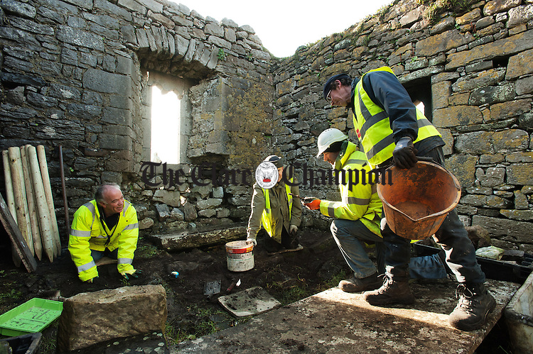 Committee members Sean O Connor, volunteer Raymond Twomey, Pat Sweeney and Richie Jones taking part in a dig as preparatory work on the site of Killilagh church in Doolin for the forthcoming restoration of a window and archway. Photograph by John Kelly.