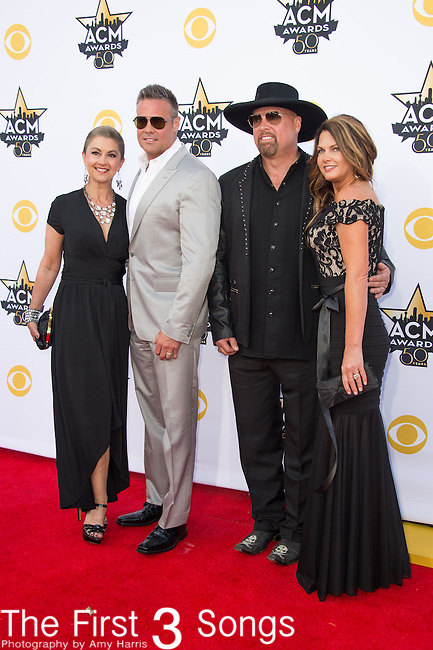Angie Gentry, recording artist Troy Gentry of the muscial duo Montgomery Gentry, Jennifer Belcher and Eddie Montgomery of the muscial duo Montgomery Gentry attend the 50th Academy Of Country Music Awards at AT&T Stadium on April 19, 2015 in Arlington, Texas.