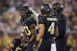 Ja'Cquez Williams (30) of the Wake Forest Demon Deacons reacts after making a play on defense during first half action against the Georgia Tech Yellow Jackets at Bobby Dodd Stadium on October 21, 2017 in Atlanta, Georgia.  The Yellow Jackets defeated the Demon Deacons 38-24. (Brian Westerholt/Sports On Film)