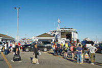 Passengers boarding ferry from Vineyard Haven for Woods Hole,  Martha's Vineyard, Massachusetts, USA