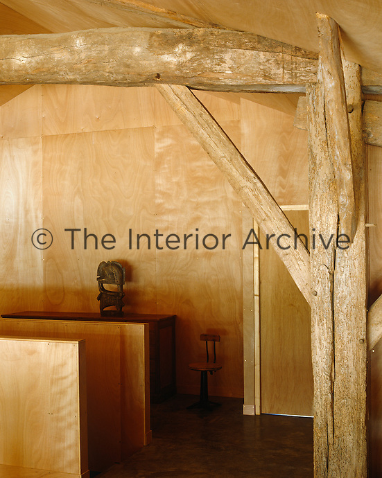 The modern untreated plywood-clad walls work well with the orginal timber rafters on the landing