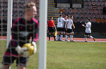 Home captain Dougie Gair celebrating opening the scoring in the Scottish pyramid play-off second leg between Edinburgh City (in white) and Cove Rangers at the Commonwealth Stadium at Meadowbank in Edinburgh. The match between the champions of the Lowland and Highland Leagues determined which club would play-off against East Stirlingshire for a place in the Scottish league. The second leg ended 1-1, giving Edinburgh City a 4-1 aggregate win.