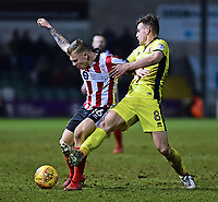 Lincoln City's Harry Anderson vies for possession with Cheltenham Town's Kevin Dawson<br /> <br /> Photographer Andrew Vaughan/CameraSport<br /> <br /> The EFL Sky Bet League Two - Lincoln City v Cheltenham Town - Tuesday 13th February 2018 - Sincil Bank - Lincoln<br /> <br /> World Copyright &copy; 2018 CameraSport. All rights reserved. 43 Linden Ave. Countesthorpe. Leicester. England. LE8 5PG - Tel: +44 (0) 116 277 4147 - admin@camerasport.com - www.camerasport.com