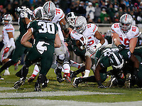 Ohio State Buckeyes running back Ezekiel Elliott (15) rushes for a touchdown in the third quarter of the college football game between the Ohio State Buckeyes and the Michigan State Spartans at Spartan Stadium in East Lansing, Saturday night, November 8, 2014. (The Columbus Dispatch / Eamon Queeney)
