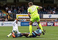 Marcus Bean of Wycombe Wanderers puts in a solid block on Sammie Szmodics of Colchester United during the Sky Bet League 2 match between Wycombe Wanderers and Colchester United at Adams Park, High Wycombe, England on 27 August 2016. Photo by Liam McAvoy.