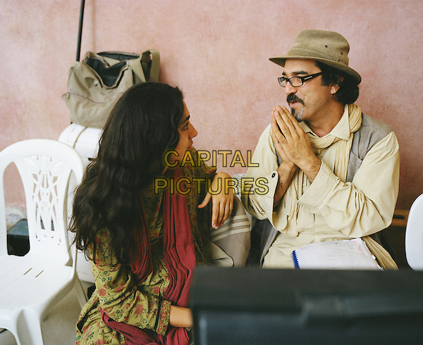 Golshifteh Farahani &amp; Director Atiq Rahimi<br /> on the set of  The Patience Stone (2012) <br /> *Filmstill - Editorial Use Only*<br /> CAP/FB<br /> Image supplied by Capital Pictures