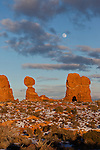 The full moon rises over Balanced Rock in Arches National Park, near Moab, Utah, at sunset.