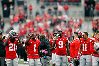 Players point at the sky after kneeling for prayer before the first half of their game against the Minnesota Golden Gophers at Ohio Stadium in Columbus, Ohio on October 13, 2018. [ Brooke LaValley / Dispatch ]