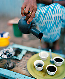 ERITREA, Tio, a woman named Sawit prepares coffee on the side of the road in Tio