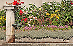 Stone fountain and colorful flowers in the town of Stampa, Switzerland where Swiss sculptor Alberto Giacometti was born