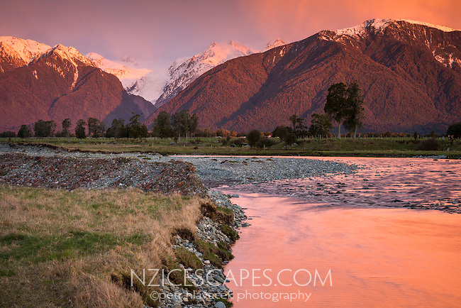 Sunset over Southern Alps with Fox River and Fox Glacier in view, Westland NP, West Coast, South Westland,  New Zealand