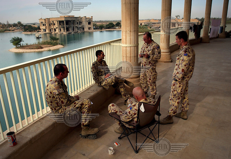 Australian troops planning their operations in the coalition compound near Baghdad airport. In the background is one of Saddam Hussein's plush palaces.