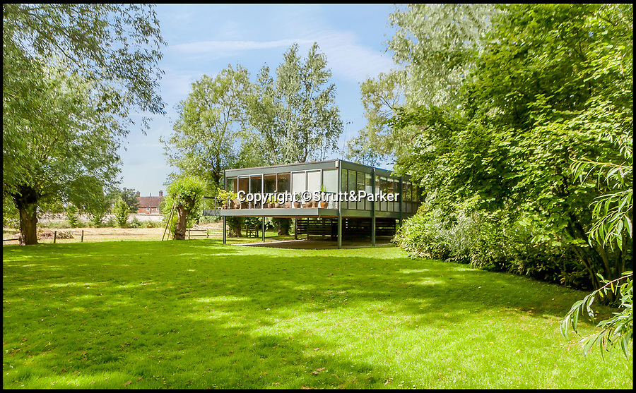 BNPS.co.uk (01202 558833)<br /> Pic: Strutt&Parker/BNPS<br /> <br /> Lush grounds surround the striking 'stilt' house.<br /> <br /> Noah Way...Escape the floods in this super cool modern ark.<br /> <br /> This amazing riverside home built on stilts has emerged for sale for £1.25million.<br /> <br /> Bridge End House in idyllic Dorchester-on-Thames, Oxon, is perched on 8ft steel girders keeping it clear of the regular floods.<br /> <br /> The architect designed home is built on seven acres of riverside land just 50ft from the River Thame, which filters into the River Thames, and floods every few years.<br /> <br /> Husband and wife architect team Donald Morrison and Julia Fielding built their future proof dream home in 1965 and lived happily there for over 50 years.
