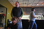 Tim Carlson, 50, of Seattle, Washington with his daughter, Mae, 4, at Rachel's coffeeshop in his hometown of Constantine, Michigan on December 22, 2010.  Of nine siblings, Carslon said five left the state for jobs and opportunities elsewhere.