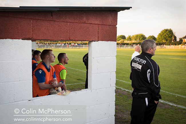 The visiting team's substitutes watching the first-half action at Yockings Park as Whitchurch Alport hosted Cammell Laird 1907 in the 2017-18 North West Counties Division One play-off final. Alport were formed in 1946 and were named after Alport Farm, Whitchurch, which had been the home of a local footballer Coley Maddocks who had been killed in action in the war. The home team won the match 2-1 watched by a crowd of 773, a club record attendance.
