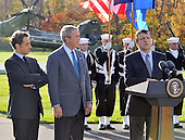 Camp David, MD - October 18, 2008 --  President José Manuel Barroso of the European Commission (EC), left, makes remarks as he and  President Nicolas Sarkozy of France, who also serves as this year's rotating President of the European Union (EU), left, are welcomed to the Presidential Retreat by United States President George W. Bush, center, on Saturday, October 18, 2008.  The two European leaders stopped at Camp David to meet with President Bush to discuss the economy on their way home from a summit in Canada to try to convince Bush to support a summit by year's end to try to reform the world financial system..Credit: Ron Sachs / Pool via CNP