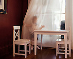 Sophia, 2, does not talk much. When she gets mad, she hides behind the curtains in the corner of the living room. Beaufort, South Carolina.