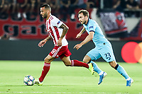 Christian Eriksen of Tottenham Hotspur in action with Guilherme of Olympiacos Fc, during the UEFA Champions League match between Olympiacos Fc and Tottenham Hotspur, in Karaiskaki Stadium in Piraeus, Greece. Wednesday 18 September 2019