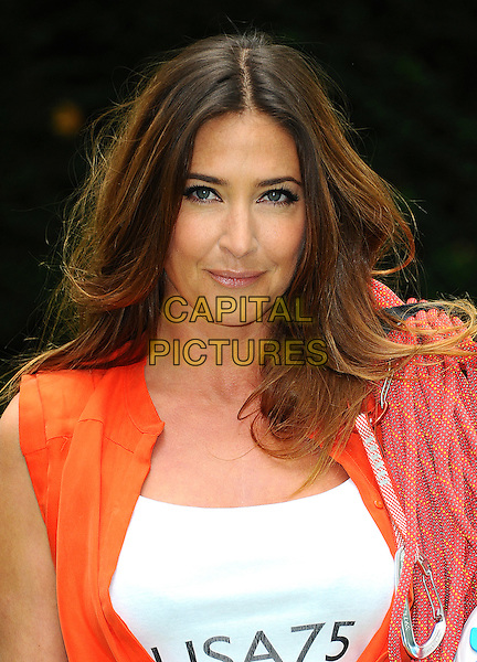 Lisa Snowdon.Photocall for Vodafone JustTextGiving Charity Challenges, London, England..5th September 2011.headshot portrait white top orange 75 rope.CAP/CJ.©Chris Joseph/Capital Pictures.