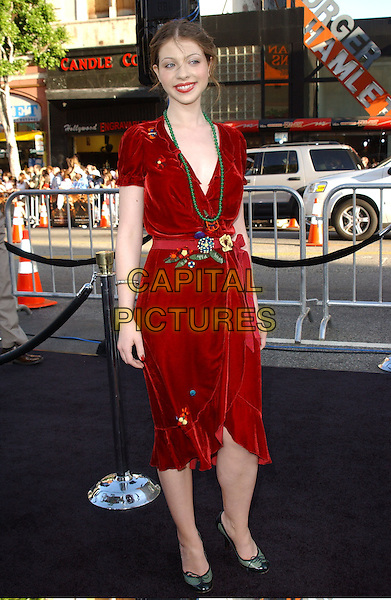 "MICHELLE TRACHTENBERG.Attends The Warner Brothers Pictures' Los Angeles Premiere of ""Batman Begins"" held at The Grauman's Chinese Theatre in Hollywood, California, USA, .June 6th 2005.full length red dress green beads necklace shoes belt.Ref: DVS.www.capitalpictures.com.sales@capitalpictures.com.©Debbie VanStory/Capital Pictures"