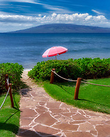 Path to beach with beach umbrella. Mauai, Hawaii