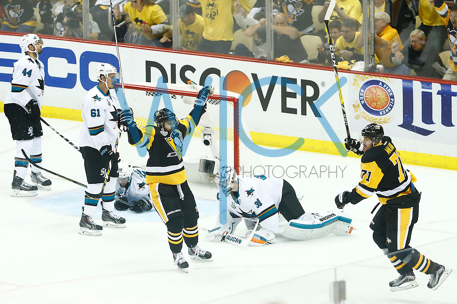Chris Kunitz #14 of the Pittsburgh Penguins and Evgeni Malkin #71 of the Pittsburgh Penguins celebrate following the goal by Malkin in the first period past Martin Jones #31 of the San Jose Sharks during game five of the Stanley Cup Final at Consol Energy Center in Pittsburgh, Pennsylvania on June 9, 2016. (Photo by Jared Wickerham / DKPS)