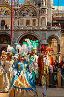Elaborate costumes paraded down a runway in Piazza San Marco during the Venice Carnival (Carnevale di Venezia), Venice, Italy.