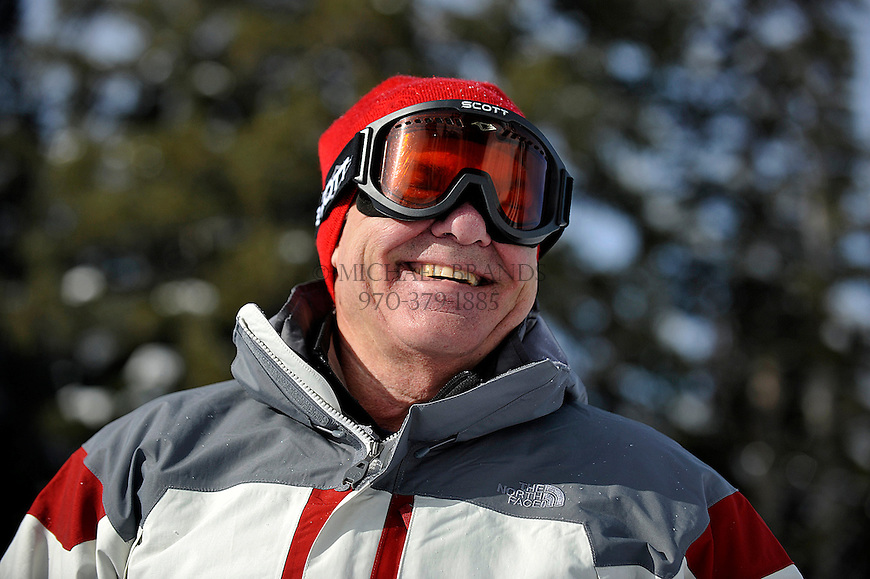 Mike Denicola, 59, of Bear Valley, CA, is all smiles after taking a tumble on Pumphouse Hill on Aspen Mountain. Michael Brands for The New York Times.