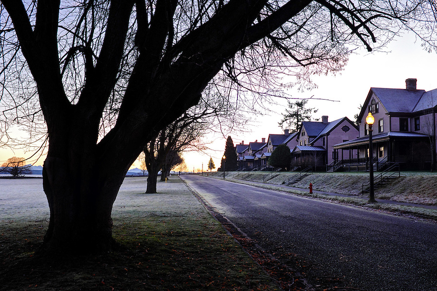 Dawn rises over Officer's Row of houses, Fort Worden State Park, Port Townsend, Washington, USA