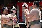 "April 29, 2016, Tokyo, Japan - Babies held by sumo wrestlers cry during the ""Nakizumo"" or ""baby-cry sumo"" competition at the Yukigaya-hachiman shrine in Tokyo on Friday, April 29, 2016. Japanese parents believe that sumo wrestlers can help make babies cry out a wish to grow up with a good health. (Photo by Yoshio Tsunoda/AFLO) LWX -ytd-"