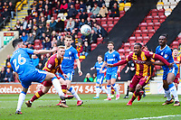 Callum Guy of Bradford City heads towards goal during the Sky Bet League 1 match between Bradford City and Gillingham at the Northern Commercial Stadium, Bradford, England on 24 March 2018. Photo by Thomas Gadd.
