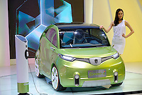 A model stands beside China's Changan Green-i concept car during the Beijing Auto Show. The car show has attracted all the world's major auto markers. China's vehicle sales have breached the 10-million barrier for the first time ever, with 10.9 million automobiles sold last year. .24 Apr 2010
