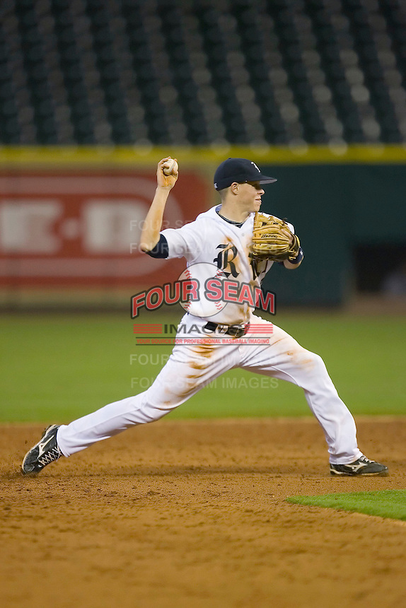Second baseman Brock Holt #7 of the Rice Owls makes a throw to first base versus the UCLA Bruins in the 2009 Houston College Classic at Minute Maid Park February 27, 2009 in Houston, TX.  The Owls defeated the Bruins 5-4 in 10 innings. (Photo by Brian Westerholt / Four Seam Images)