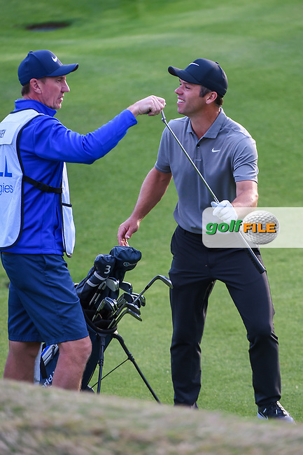 Paul Casey (GBR) shares a laugh with his caddie as he prepares to putt on 2 during day 4 of the WGC Dell Match Play, at the Austin Country Club, Austin, Texas, USA. 3/30/2019.<br /> Picture: Golffile | Ken Murray<br /> <br /> <br /> All photo usage must carry mandatory copyright credit (© Golffile | Ken Murray)