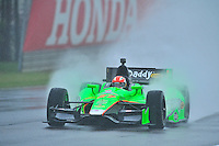 James Hinchcliffe, of Canada, shoots a rooster tail of rain during an IZOD Indycar Series practice session Friday afternoon at Barber Motorsports Park in Birmingham, Alabama.