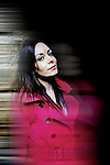 Dark haired Woman in pink jacket, motion blur