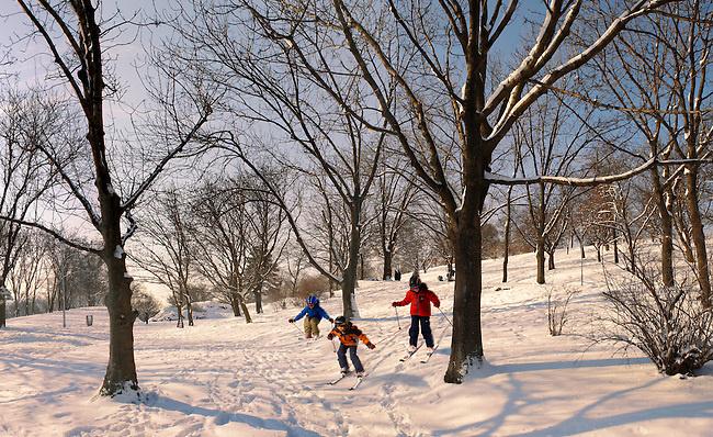 Városliget. Children skiing in the City park in the snow - Budapest Hungary