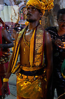 man in trance while Thaipusam ceremonies inside Batu Caves, Kuala Lumpur, Malaysia, 2012. Thaipusam ceremonies, celebrated by tamile Hindu community in Malaysia, take place  in Sanctuary of Batu Caves at the border of Kuala Lumpur, each year around end of January or beginning of February, according to Hindu moon calendar. The event is paying hommage to Lord Murugan, a spirit or god created by Shiva to lead the army of gods against the army of evil demons, finally defeating the evil spirits. There are many ways to present offerings or sacrifices for this major religious event. Devotees mortify their bodies by carrying heavy kavaris with spears fixed in their skin or fruits, flowers and little post with holy milk fixed with hooks in their skin, ascending the stairways to the sanctuary in trance, `followed by assistant  taking care and musicians playing loud and fast rhythmic trance music.  Many families shave their head in a ritual before ascending the stairways, as part of rituals to obtain salvation for their ancestors.