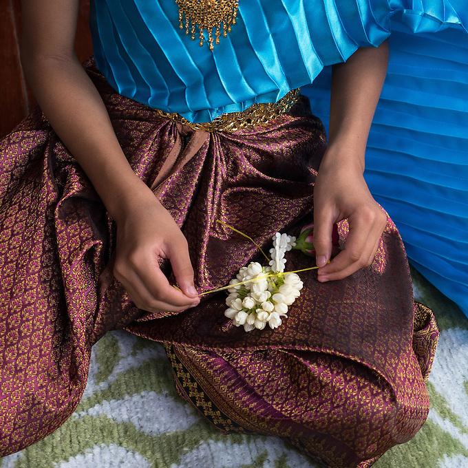 Traditional dressed Thai Girls preparing flowers, Phra Nakhon Si Ayutthaya