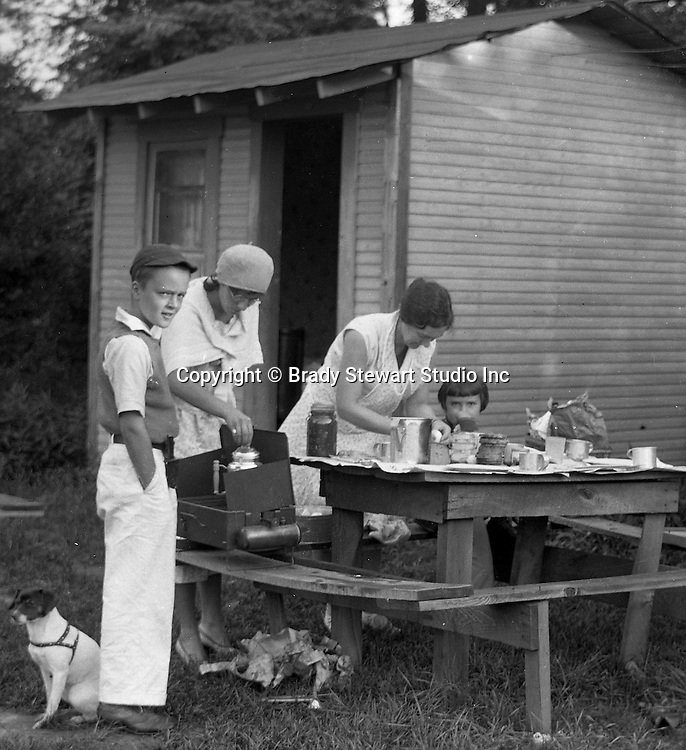 Markleysburg PA:  Stewart family camping out at the Lone Star Inn's cabins near Youghiogheny Lake - 1931.  Pepe, Brady Jr., Helen, Sara and Sally taking a break for lunch.