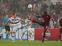 Bayer's Mario Gotz challanges  Roma's Mapou Yanga-Mbiwa   during the Champions League Group E soccer match between As Roma and FC Bayern Munchen at the Olympic Stadium in Rome october 21 , 2014.