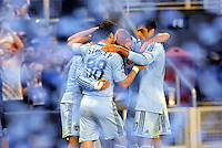 Sporting KC players celebrate Soony Saad's equalizing goal amongst the blue paper... Sporting Kansas City played Chivas Guadalajara to a 2-2 tie at LIVESTRONG Sporting Park, Kansas City, Kansas in an international friendly.