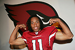 The Arizona Cardinals today unveiled their new uniforms for the 2005/2006 season.  Here wide reciever Larry Fitzgerald strikes a pose on the runway.