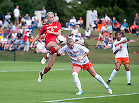 Shasta Fisher (12) of Virginia collides with Ashley Spivey (8) of Maryland during the game at Klockner Stadium in Charlottesville, VA.  Virginia defeated Maryland, 1-0.
