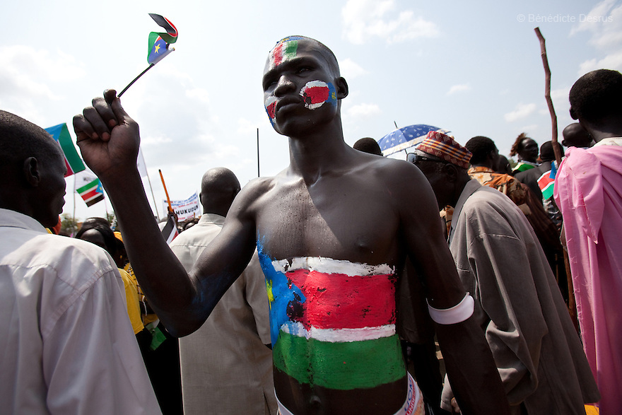 Saturday 9 july 2011 - Juba, Republic of South Sudan - A man with his head and body painted in the colours of South Sudan's national flag attends the Independence Day celebrations in the capital Juba. Tens of thousands of citizens of the new South Sudan celebrate national independence but whether statehood will resolve issues of identity after a decades-long war remains to be seen. Photo credit: Benedicte Desrus