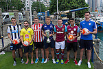 From left to right: Newcastle United's Dan Barlaser, Wellington Phoenix's Justin Gulley, Stoke City's Lewis Banks, Hong Kong Football Club's Gary Gheczy, West Ham United's Lewis Page, Aston Villa's Khalid Abdo, and Leicester City's Elliott Moore pose for a photograph near the Noon Day Gun to celebrate the launch of the HKFC Citi Soccer Sevens on 19 May 2016 in Causeway Bay, Hong Kong, China. Photo by Lucas Schifres / Power Sport Images