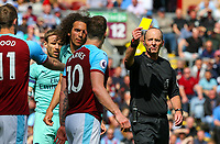 Referee Michael Dean shows Burnley's Ashley Barnes the yellow card<br /> <br /> Photographer Alex Dodd/CameraSport<br /> <br /> The Premier League - Burnley v Arsenal - Sunday 12th May 2019 - Turf Moor - Burnley<br /> <br /> World Copyright © 2019 CameraSport. All rights reserved. 43 Linden Ave. Countesthorpe. Leicester. England. LE8 5PG - Tel: +44 (0) 116 277 4147 - admin@camerasport.com - www.camerasport.com
